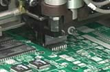 Surface mount machine placing circuit chips